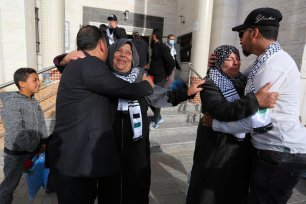 Palestinians hug their loved ones after being released from quarantine in Gaza after 21 days on 8 April 2020 [Mohammed Asad/Middle East Monitor]