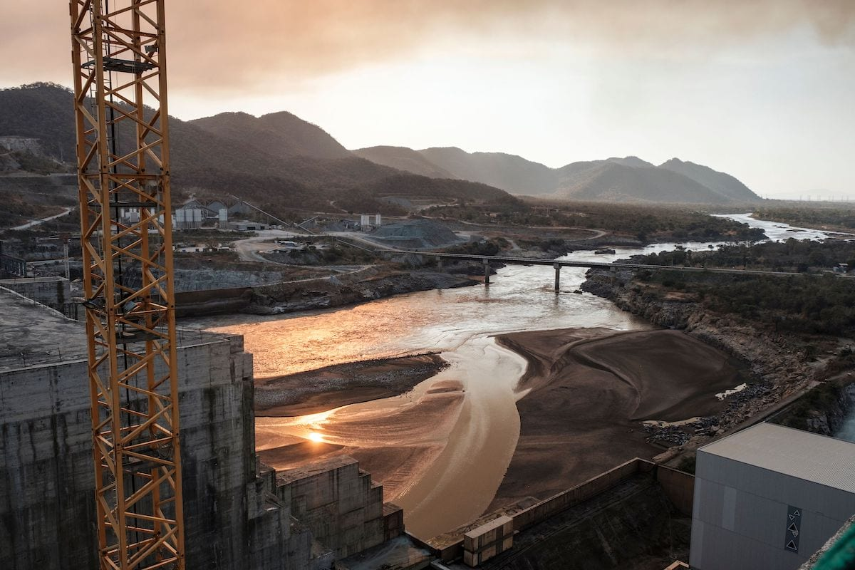 A general view of the Blue Nile river as it passes through the Grand Ethiopian Renaissance Dam (GERD), near Guba in Ethiopia, on 26 December 2019. - The Grand Ethiopian Renaissance Dam, a 145-metre-high, 1.8-kilometre-long concrete colossus is set to become the largest hydropower plant in Africa. Across Ethiopia, poor farmers and rich businessmen alike eagerly await the more than 6,000 megawatts of electricity officials say it will ultimately provide. Yet as thousands of workers toil day and night to finish the project, Ethiopian negotiators remain locked in talks over how the dam will affect downstream neighbours, principally Egypt. [EDUARDO SOTERAS/AFP via Getty Images]