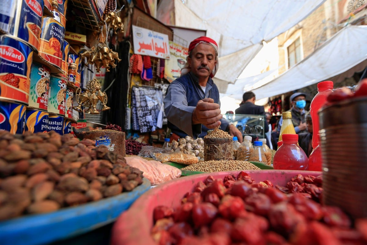 A Yemeni vendor waits for costumers in the old city market of the capital Sanaa, Yemen on 18 April 2020 [MOHAMMED HUWAIS/AFP/Getty Images]
