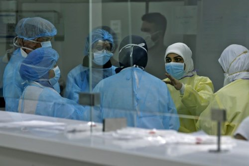 Medical personnel, treating patients suffering from coronavirus (COVID-19), in the Lebanese capital Beirut on 7 April 2020 [JOSEPH EID/AFP/ Getty Images]