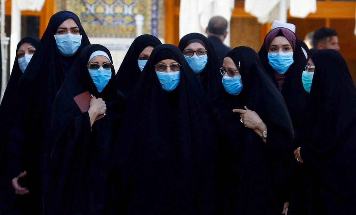 Iraqi women wear protective face masks following an outbreak of coronavirus, in Iraq on 11 March 2020 [REUTERS/Alaa al-Marjani/TPX IMAGES OF THE DAY - RC2SHF9HZ5AN]