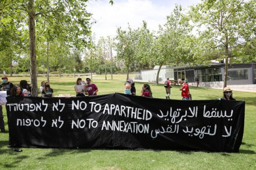 A group of Israeli activists, holding banners, gather in front of U.S Embassy as they stage a demonstration to protest against the annexation plan of Jordan Valley, and illegal Jewish settlements in West Bank, on 15 May 2020 in Jerusalem. [Mostafa Alkharouf - Anadolu Agency]