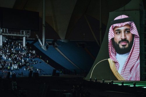 A portrait of Saudi Crown Prince Mohammed bin Salman appears during a show as a part of celebrations of the 88th Saudi National Day at the King Fahad stadium on September 23, 2018 in Riyadh [FAYEZ NURELDINE/AFP via Getty Images]