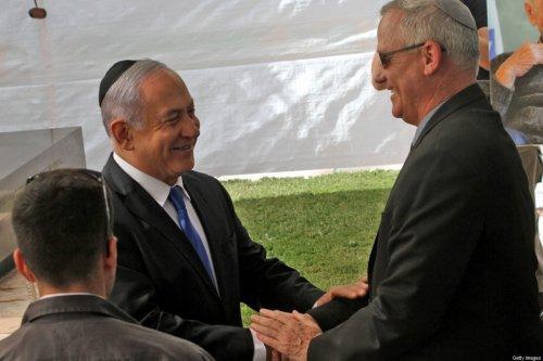 Israeli Prime Minister Benjamin Netanyahu (L) greets Benny Gantz in Jerusalem on 19 September 2019 [GIL COHEN-MAGEN/AFP/Getty Images]