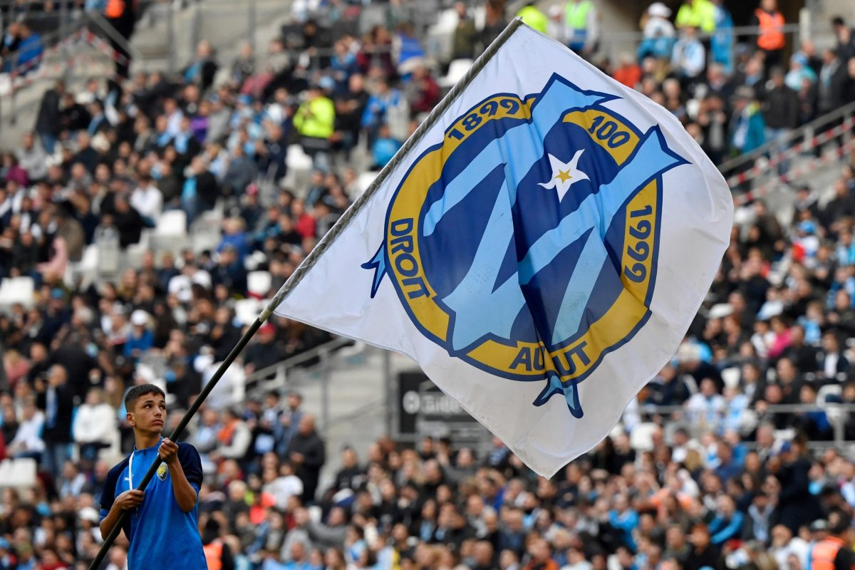 Olympique Marseille's flag with the logo is waved prior to the French L1 football match at the Velodrome Stadium in Marseille on 22 February, 2020 [GERARD JULIEN/AFP via Getty Images]