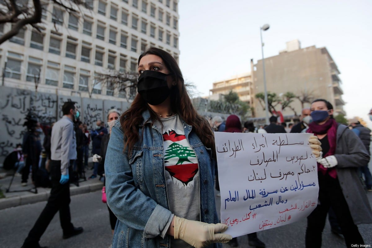 Lebanese protesters gather in front of the central bank building and block the main street that leads to the Hamra neighbourhood of the capital Beirut, on April 23, 2020 [ANWAR AMRO/AFP via Getty Images]