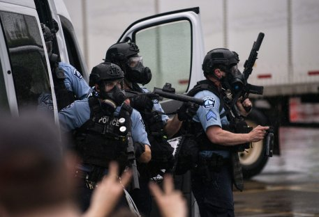 Police dressed in tactical gear attempt to disperse crowds gathered to protest the death of George Floyd outside the 3rd Precinct Police Station on May 26, 2020 in Minneapolis, Minnesota. [Stephen Maturen/Getty Images]