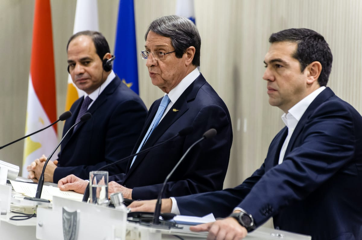 Cypriot President Nicos Anastasiades (C), Greek prime minister Alexis Tsipras and Egyptian President Abdel Fattah al-Sisi (L) attend a press conference at the presidential palace in Nicosia on 21 November 2017. [IAKOVOS HATZISTAVROU/AFP via Getty Images]