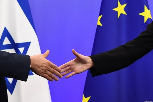 Israel's Prime Minister Benjamin Netanyahu (L) and EU foreign policy chief, Federica Mogherini shake hands during a press conference at the European Council in Brussels on December 11, 2017 [EMMANUEL DUNAND/AFP via Getty Images]