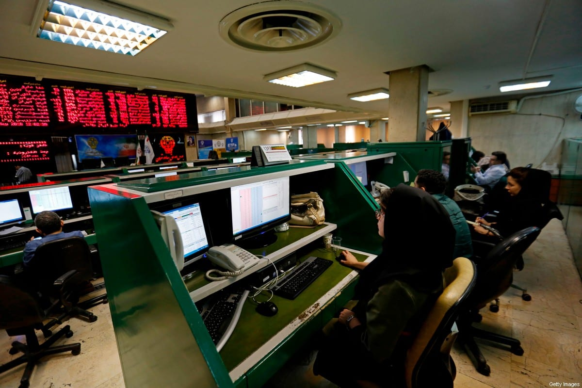 Iranian dealers monitor the stock market at the stock exchange in the capital Tehran on May 8, 2018 [ATTA KENARE/AFP via Getty Images]