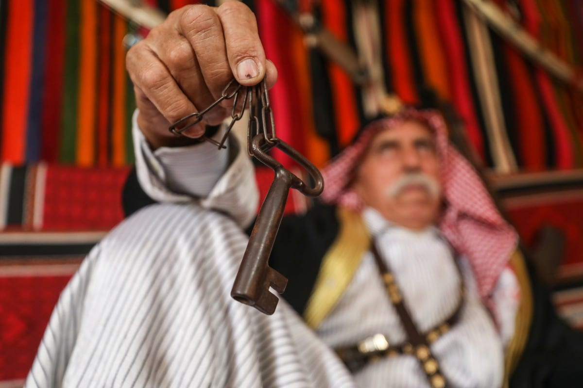 A Palestinian mad holds the keys to his house in Bi'r Muin town, which he and his family were forced to leave during the Nakba, 12 May 2020 [Ali Jadallah/Anadolu Agency]