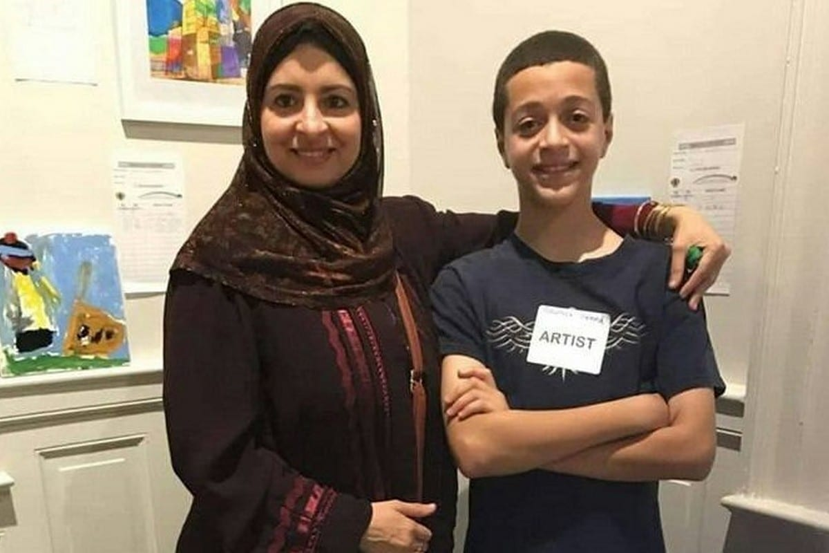 Reem Desouky and her son before she was arrested by Egyptian forces, 19 July 2019 [Breakcuffs_eng/Twitter]