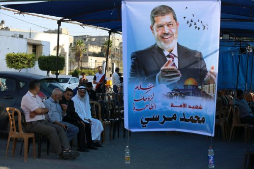Palestinians receive condolences for the death of Egypt's former president Mohammed Morsi, in Khan Younis in the southern Gaza Strip on 19 June 2019. [Ashraf Amra/Apaimages]