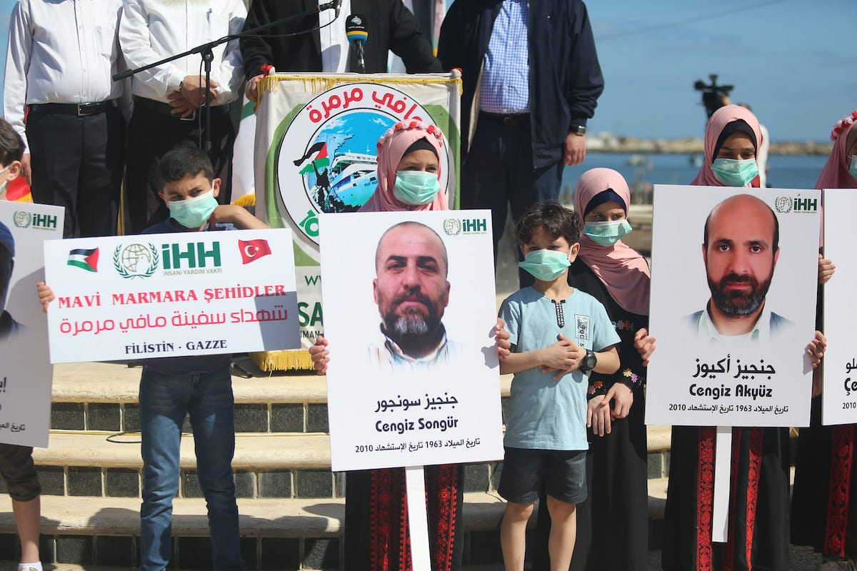 Palestinians hold photos of those who lost their lives in 2010 Mavi Marmara flotilla incident during a commemoration ceremony organized by IHH Humanitarian Relief Foundation, in Gaza City, Gaza on 31 May 2020. [Mustafa Hassona - Anadolu Agency]