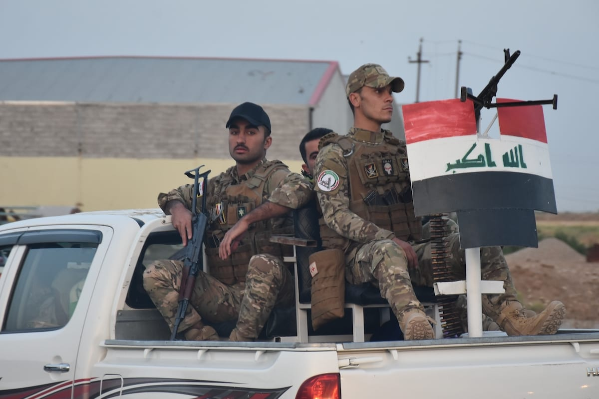 Members of Iraqi forces are seen in a truck during the operation launched against Daesh in Southwestern of Kirkuk, Iraq on 2 June 2020. [Ali Makram Ghareeb - Anadolu Agency ]