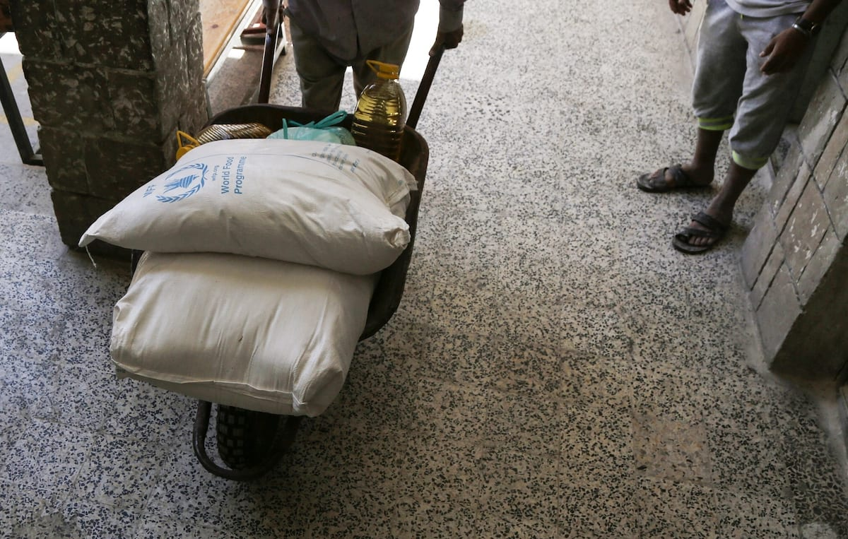 Food aid sent by World Food Program (WFP) is being distributed to needy people in Yemeni capital city Sanaa on 3 June 2020. [Mohammed Hamoud - Anadolu Agency]