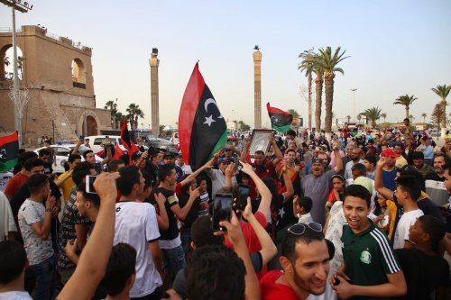 People gather at Martyrs' Square to celebrate after seizing control of the Tripoli's provincial administrative boundaries on 4 July 4, 2020 in Tripoli, Libya. [Hazem Turkia - Anadolu Agency]