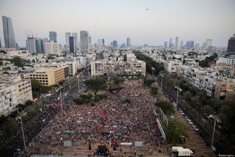 Israelis gather to stage a demonstration, while observing social distancing, to protest against Israel's annexation plan for the illegal settlements in West Bank and Jordan Valley, in Tel Aviv, Israel on June 6, 2020 [Nir Keidar / Anadolu Agency]