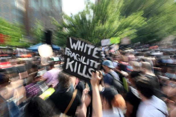 A sign that says 'White Fragility Kills' is seen where New Yorkers protest over the death of George Floyd at the Washington Square Park in New York City, United States on June 6, 2020. [Tayfun Coşkun - Anadolu Agency]