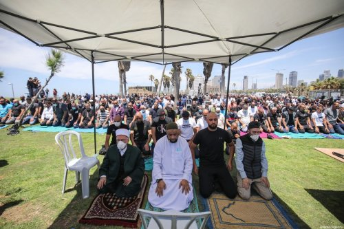 The grand imam of Al-Aqsa Mosque Sheikh Ekrima Sabri (R), leads a Friday prayer in the open area ahead of a protest as dozens of Palestinian residents of Jaffa gather to protest the destruction of the historic Muslim Al-Isaf cemetery affiliated to Tel Aviv municipality by Israeli authorities in Jaffa, Israel on June 12, 2020 [Mostafa Alkharouf / Anadolu Agency]