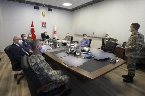 Minister of National Defence of Turkey, Hulusi Akar (Rear C) and the Turkish Armed Forces Command are managing and dispatching the Operation Claw-Tiger from the Army Command Control Center in Ankara, Turkey on 17 June 2020. [Arif Akdoğan - Anadolu Agency]