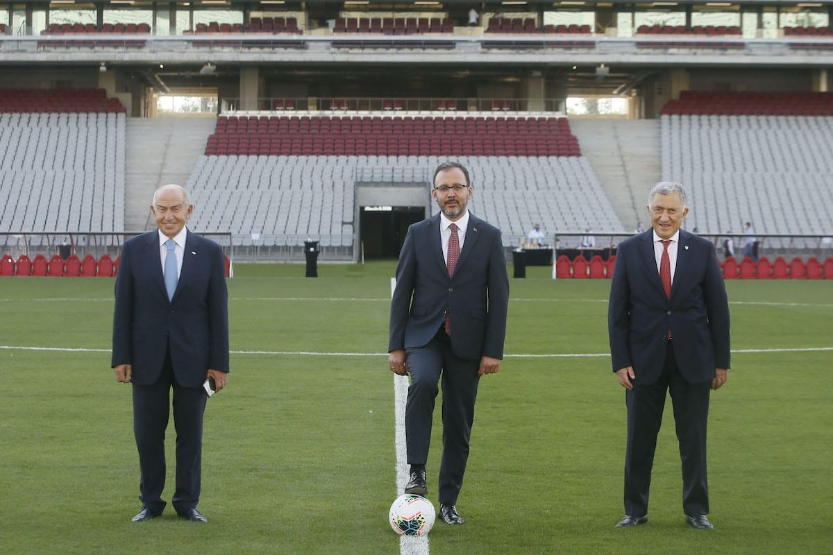 Turkish Minister of Youth and Sports, Mehmet Muharrem Kasapoglu (C) and Turkish Football Federation President Nihat Ozdemir (L) are seen at Ataturk Olympic Stadium before holding a meeting to evaluate UEFA Board of Directors's decisions in Istanbul, Turkey on 17 June 2020. [Erhan Elaldı - Anadolu Agency]