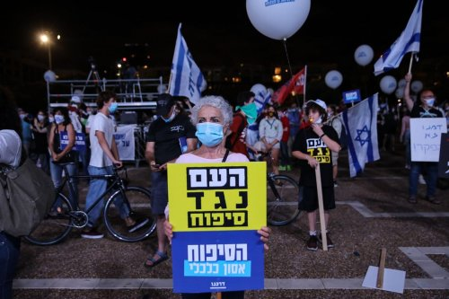 People gather in Tel Aviv to protest against Jewish settlements and Israel's annexation plan of the West Bank on 23 June 2020 [Mostafa Alkharouf/Anadolu Agency]