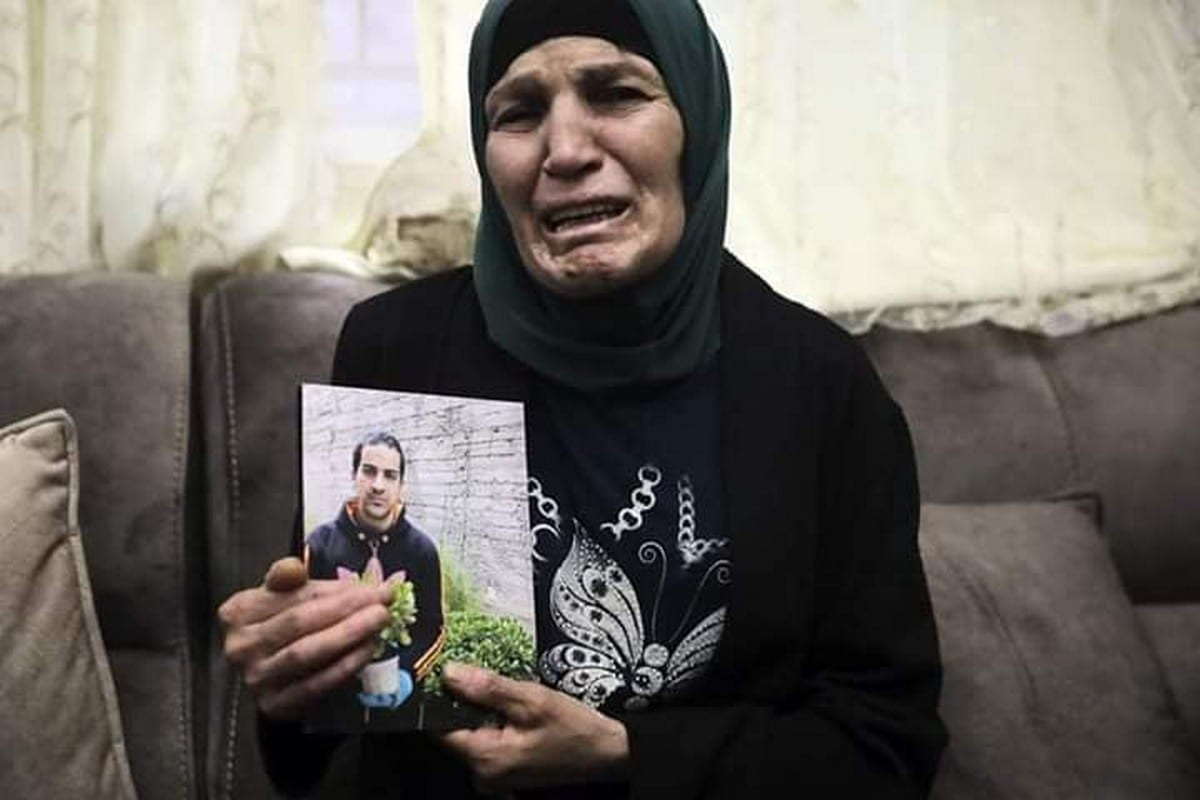 The mother of Eyad Hallaq, an autistic Palestinian man who was killed by Israeli forces in Jerusalem on 30 May 2020 [Twitter]