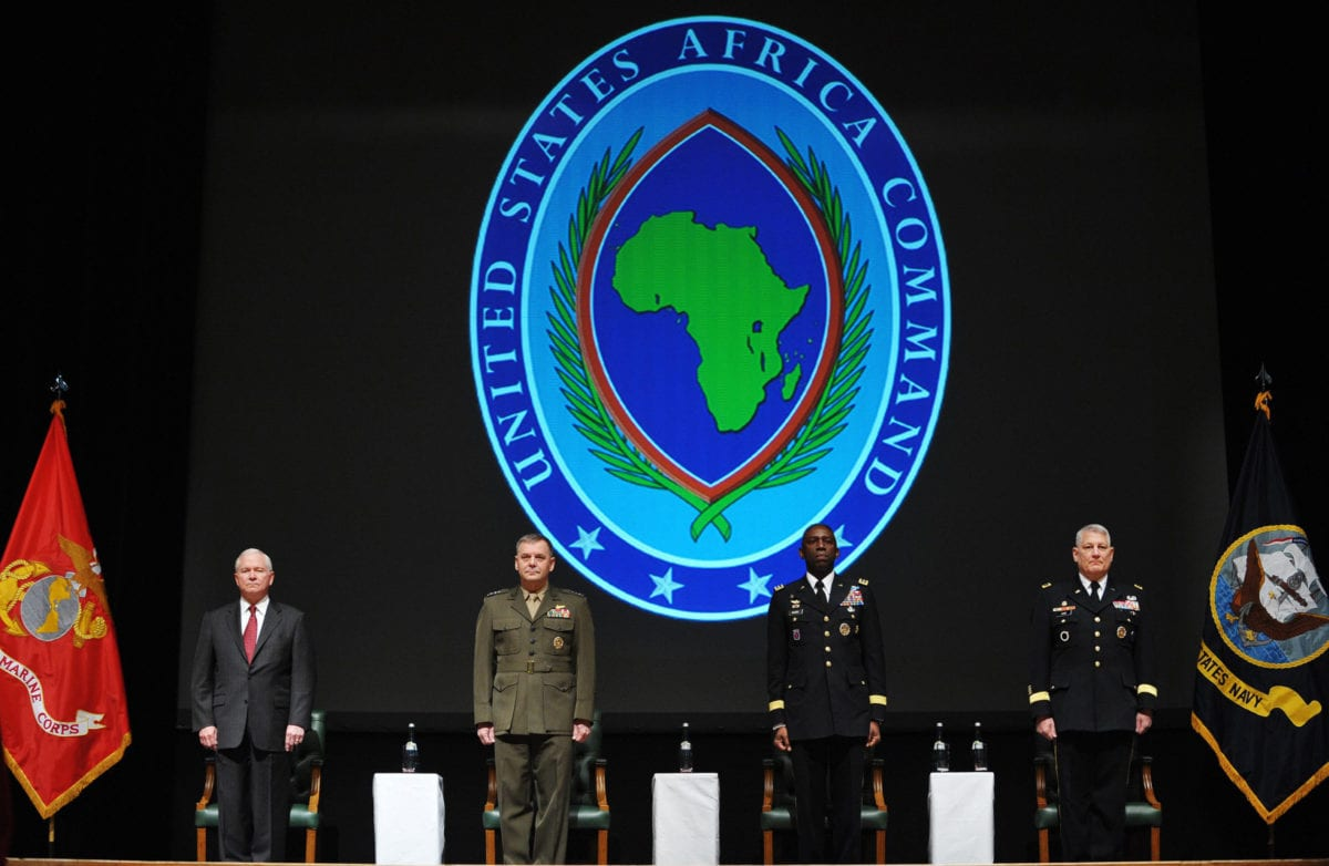 US Defense Secretary Robert Gates, Vice Chairman of the Joint Chiefs of Staff US General James Cartwright, outgoing Africa Command commander US General William Ward and incoming Africa Command commander US General Carter Ham take part in the AFRICOM change of command ceremony on March 9, 2011 in Sindelfingen near Stuttgart, Germany. [Mandel Ngan-Pool/Getty Images]