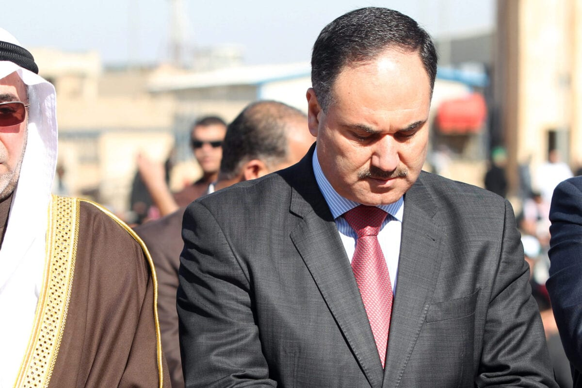 Iraqi Finance Minister Rafi al-Issawi (R) perform the weekly Friday noon prayers at the Sunni Umm al-Qura mosque in Baghdad on January 11, 2013 [AHMAD AL-RUBAYE/AFP via Getty Images]