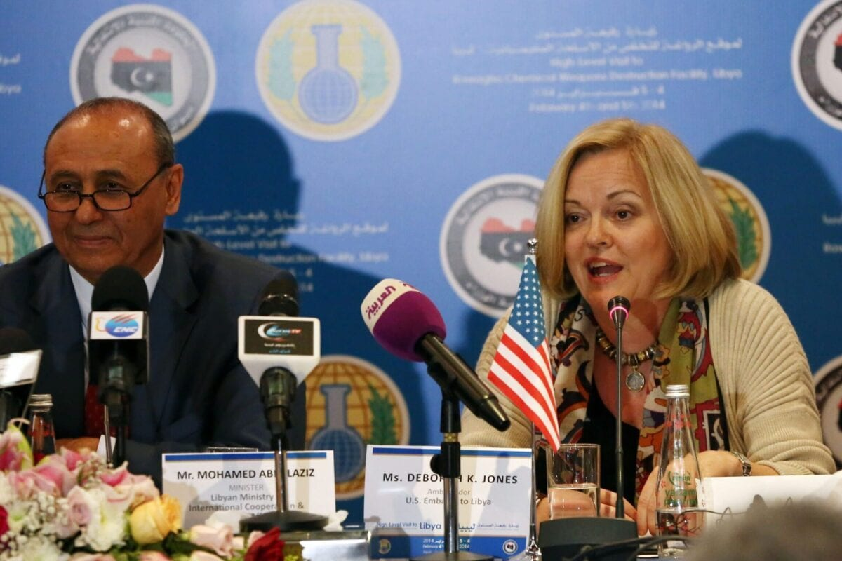 US Ambassador to Libya Deborah Jones (R) speaks, as Libyan Foreign Affairs Minister Mohamed Abdulaziz (L) looks on, during a press conference in Tripoli on February 4, 2014. [MAHMUD TURKIA/AFP via Getty Images]