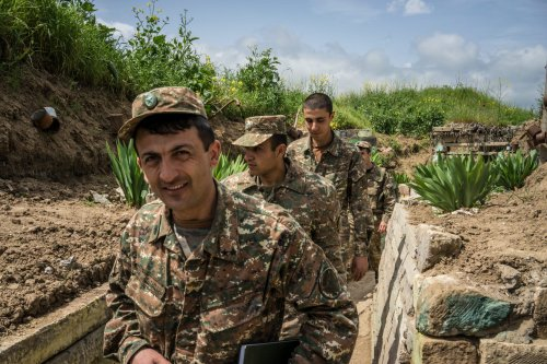 Members of the armed forces of Nagorno-Karabakh at their post along the line of contact with Azerbaijani forces on 21 April 2015 [Brendan Hoffman/Getty Images]