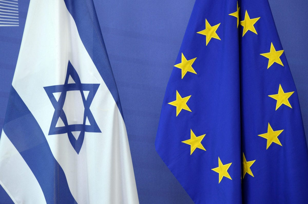 An Israeli flag is set next to a European Union flag at the European Union Commission headquarters in Brussels on June 23, 2016 [THIERRY CHARLIER/AFP via Getty Images]