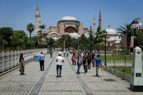 Tourists around Sultanahmet Square and Hagia Sophia in Istanbul, Turkey on 7 June 2020 [Mehmet Eser/Anadolu Agency]