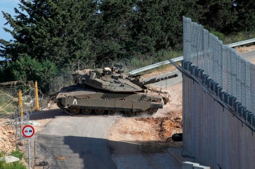 A battle tank belonging to the Israeli army is seen the Lebanon border on 2 June 2020 [JALAA MAREY/AFP/Getty Images]