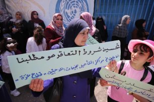 Palestinian in Gaza protest against UNRWA's decision to terminate the temporary contracts of 106 staff, 10 June 2020 [Mohammed Asad/Middle East Monitor]