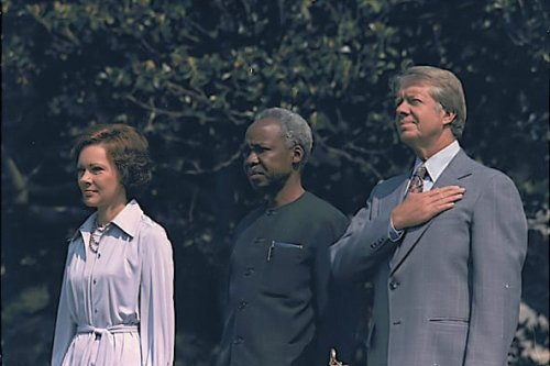 Rosalynn Carter, President Julius Nyerere of Tanzania and Jimmy Carter, on 4 August 1977 [Wikipedia] *4 August 1977