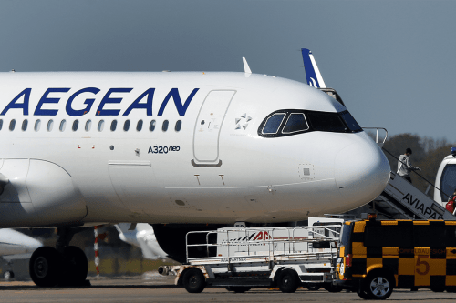 An Aegean airline aircraft on the tarmac at the airport on April 8, 2020 [RONNY HARTMANN/AFP via Getty Images]