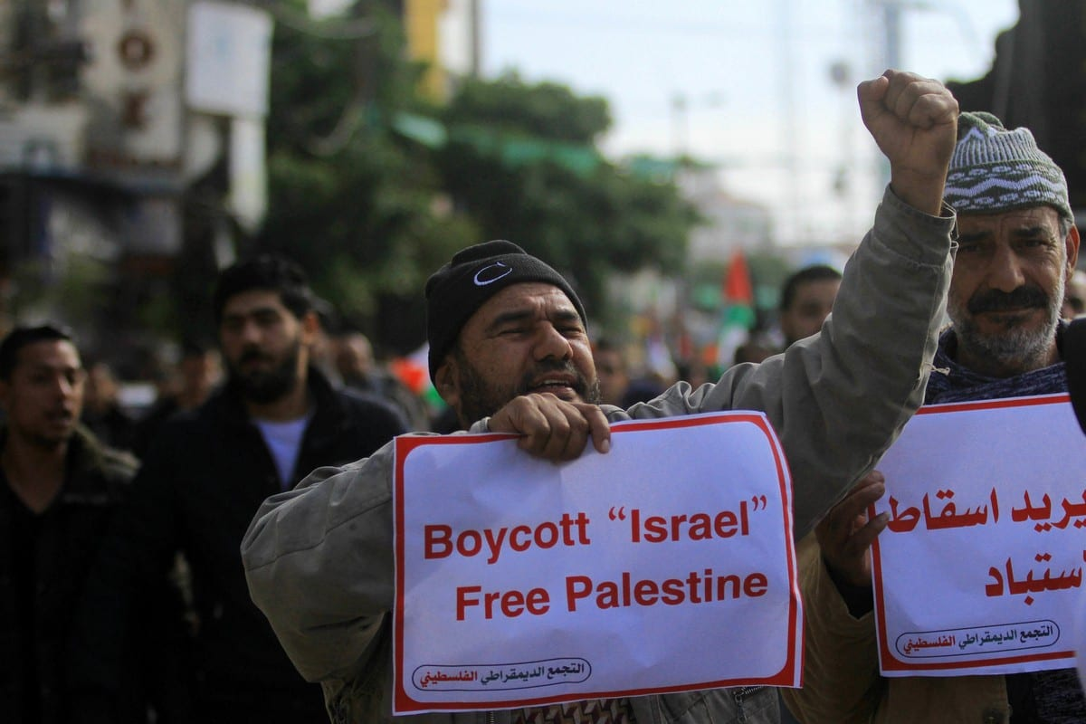 Palestinians protest against the deal of the century, in Gaza City on 12 January 2019 [Mahmoud Ajjour/ApaImages]