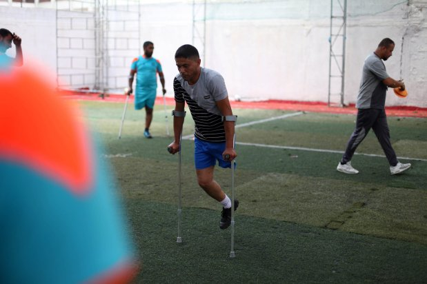 Disabled Palestinians who lost their legs by Israeli troops during clashes at Gaza-Israel border, take part in the Football training, at Palestine Club in Gaza city on 6 July, 2020 [Mahmoud Ajjour/Apaimages]