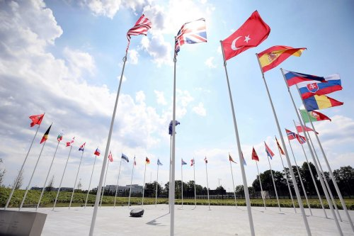The flags of members of North Atlantic Treaty Organization (NATO) are seen at the Headquarter of NATO in Brussels, Belgium on 26 June 2020. [Dursun Aydemir - Anadolu Agency]