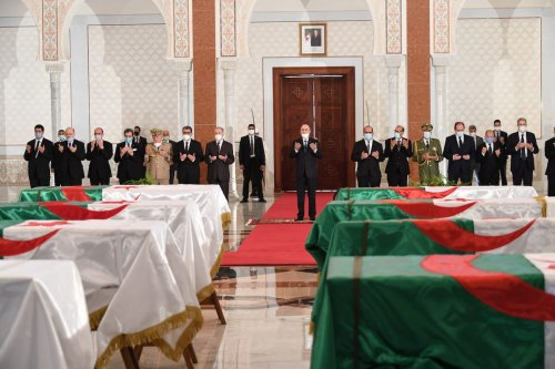 The remains of 24 of Algeria's independence fighters killed during the Algerian popular resistance against French colonialism brought by plane from France, and welcomed by Algerian President Abdelmadjid Tebboune (C) in Algiers, Algeria on 3 July 2020. [Algerian Presidency / Handout - Anadolu Agency]