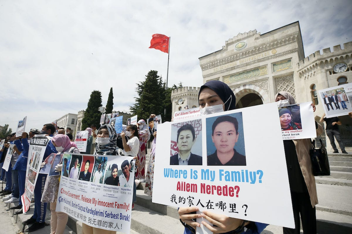 Uyghur Turks living in Istanbul gather to protest China for their family members, who have been held in Chinese camps on 27 July 2020 [Erhan Elaldı/Anadolu Agency]