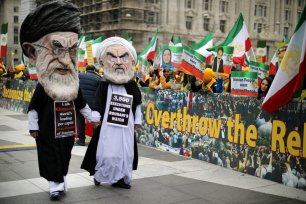 People wearing caricature masks of Iranian Supreme leader Ali Khamenei and President Hassan Rouhani participate in a rally hosted by The Organisation of Iranian-American Communities in Freedom Plaza on 8 March, 2019 in Washington, DC [Chip Somodevilla/Getty Images]