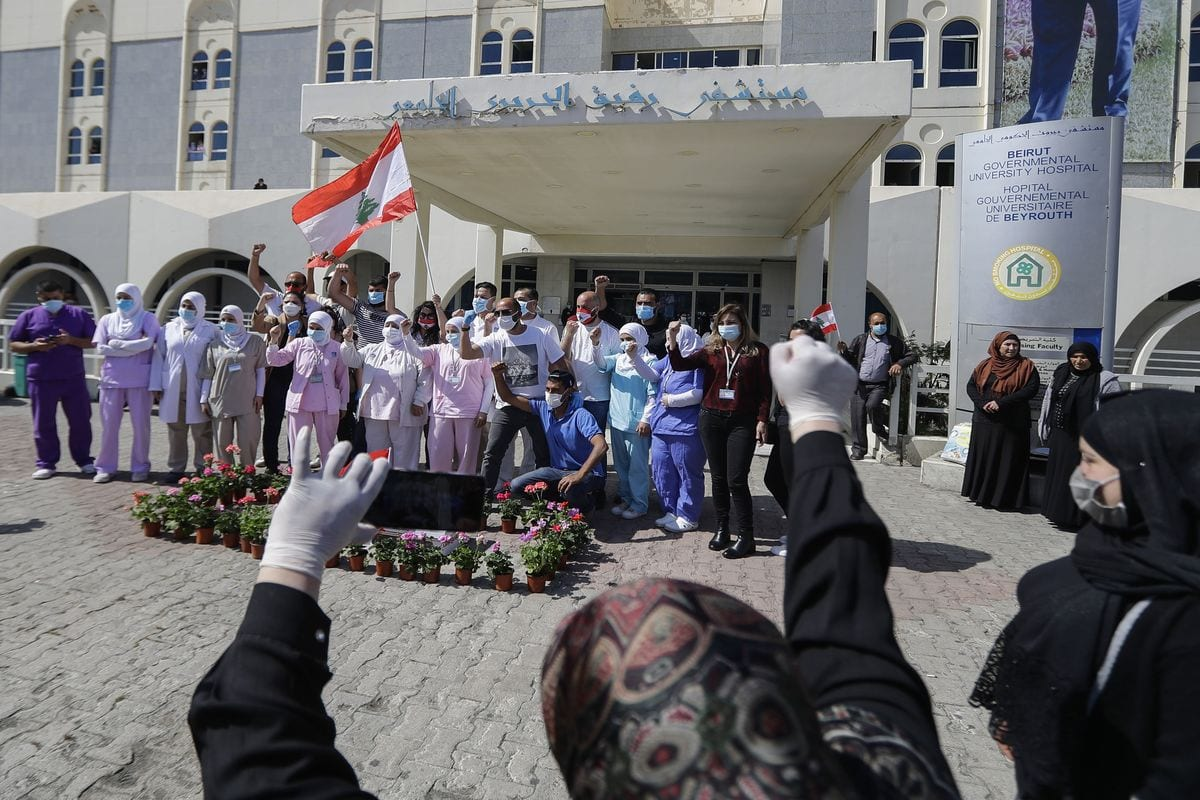 Lebanese nurses at the Rafik Hariri public hospital in Lebanon's capital Beirut, on 12 May, 2020 [JOSEPH EID/AFP via Getty Images]