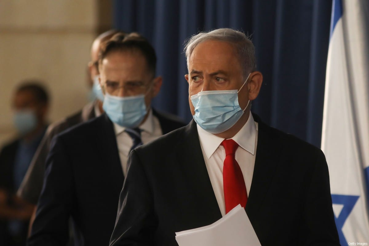 Israeli Prime Minister Benjamin Netanyahu arrives to the weekly cabinet meeting in Jerusalem on June 7, 2020 [MENAHEM KAHANA/AFP via Getty Images]