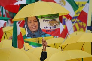 A demonstrator holds up a portrait of Iranian opposition leader Maryam Rajavi on 17 July, 2020 in Berlin, Germany [Sean Gallup/Getty Images]