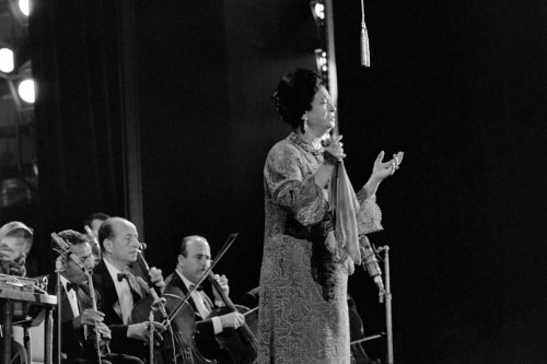 Egyptian singer Umm Kulthum performs on November 14, 1967 at the Olympia concert hall, in Paris [STRINGER/AFP via Getty Images]