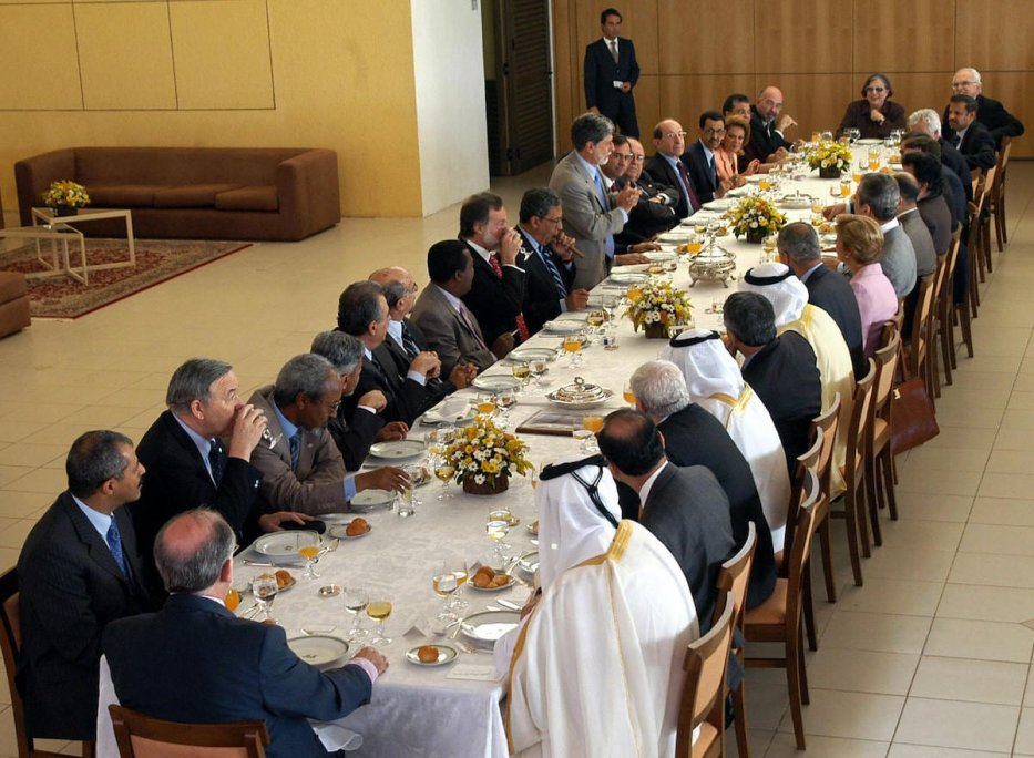 Brazil's Celso Amorim (C/L-standing) addresses a lunch with Arab Foreign Ministers in the framework of the Summit of South American and Arab Countries in Brasilia, on 09 May 2005. [GUSTAVO MAGALHAES/AFP via Getty Images]