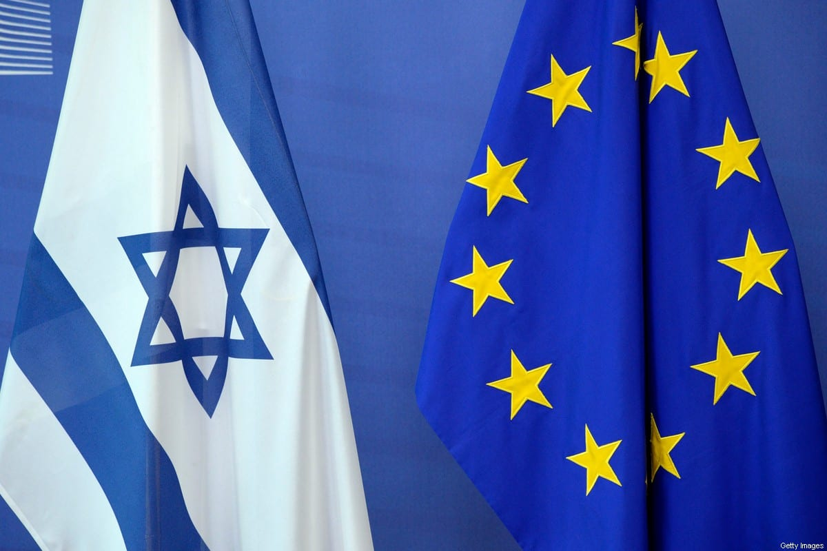 An Israeli flag is set next to a European Union flag at the European Union Commission headquarters in Brussels on June 23, 2016. / AFP / THIERRY CHARLIER (Photo credit should read THIERRY CHARLIER/AFP via Getty Images)